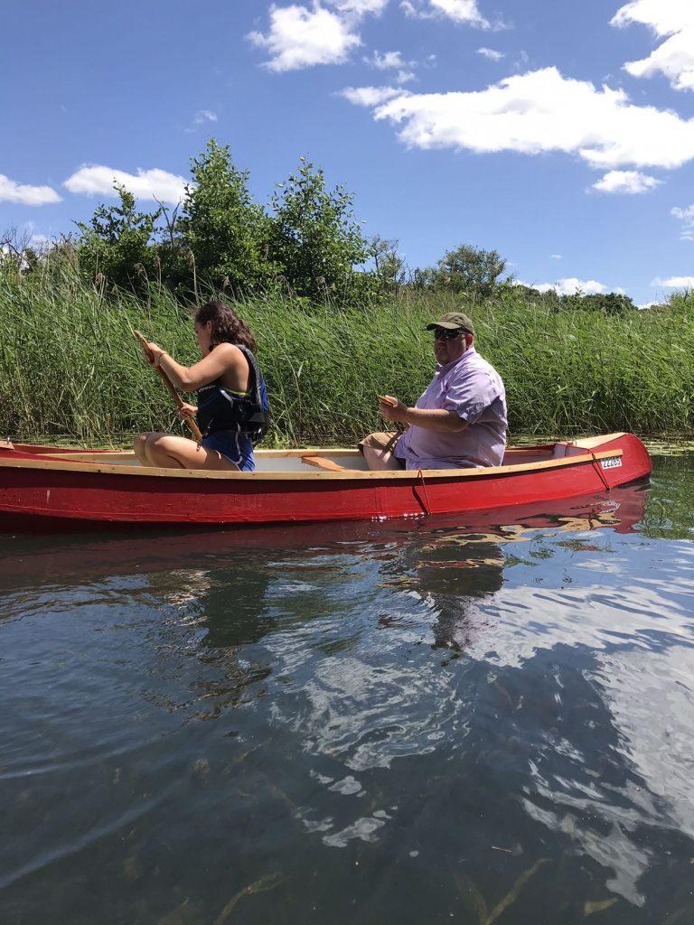 Farmer in canoe